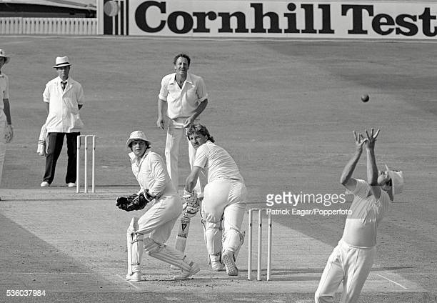 Ian Botham of England watches as Geoff Howarth of New Zealand takes the catch to dismiss him off the bowling of Jeremy Coney of New Zealand during...
