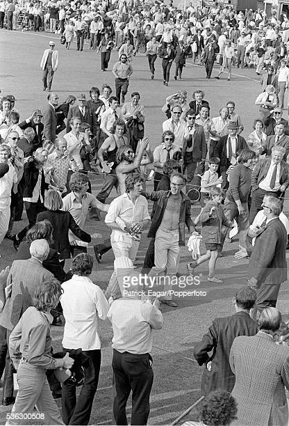 Ian Botham of Somerset is applauded off the pitch after hitting the winning runs during the Benson and Hedges Cup quarterfinal between Somerset and...