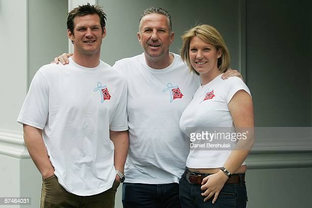 Ian Botham poses for a photograph with son Liam Botham and daughter Sarah Botham after a press conference to launch his charity walk for cancer on...