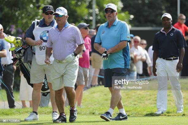 Ian Botham walks with Allan Lamb and Brian Lara during the Pro Am for the BMW PGA Championship at Wentworth on May 23, 2018 in Virginia Water,...
