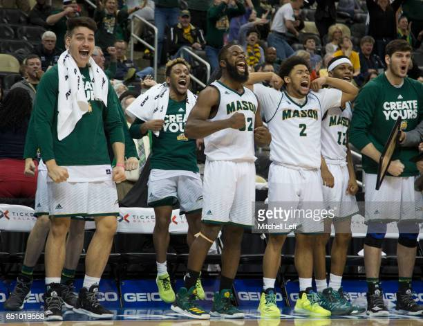 Ian Boyd, Kameron Murrell, Karmari Newman and the rest of the George Mason Patriots bench reacts against the Fordham Rams in the second round of the...