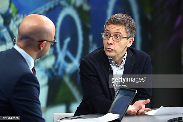 Ian Bremmer, chief executive officer of Eurasia Group Ltd., right, a political consultancy group, speaks during a Bloomberg Television interview in...