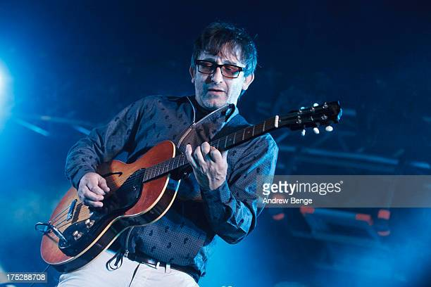 Ian Broudie of The Lightning Seeds performs on stage on Day 1 of Kendal Calling Festival at Lowther Deer Park on July 26 2013 in Kendal England