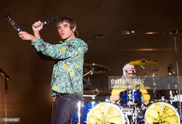 Ian Brown and Reni of The Stone Roses headline The Virgin Media Stage on day 1 of the V Festival at Hylands Park on August 18 2012 in Chelmsford...