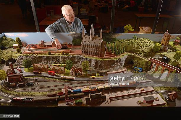Ian Bruce tinkers with a model train as enthusiasts gather for the Model Rail Scotland exhibition on February 21 2013 in Glasgow Scotland Model...