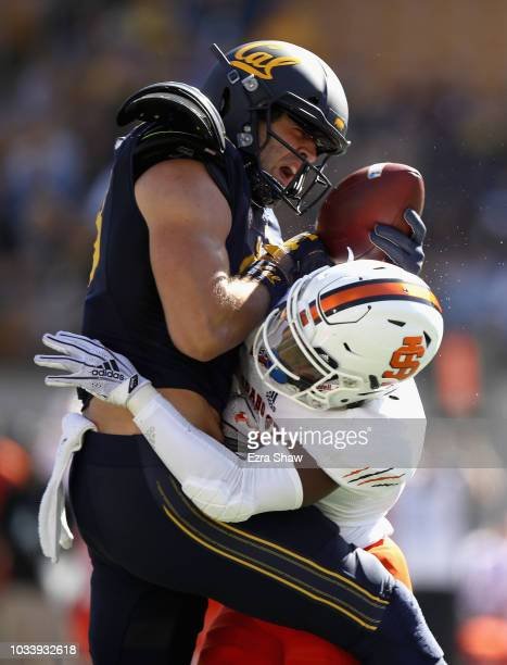 Ian Bunting of the California Golden Bears is hit by Christian McFarland of the Idaho State Bengals after he caught a pass at California Memorial...
