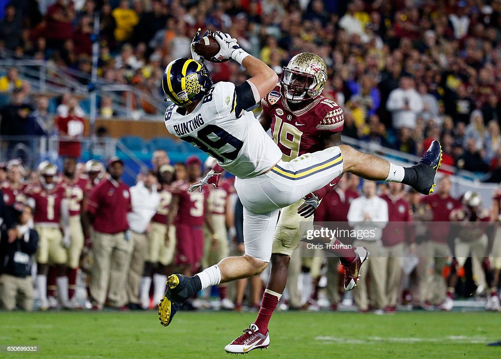 Ian Bunting #89 of the Michigan Wolverines completes a first down pass against the defense of A.J. Westbrook #19 of the Florida State Seminoles in the third quarter during the Capitol One Orange Bowl at Sun Life Stadium on December 30, 2016 in Miami Gardens, Florida.