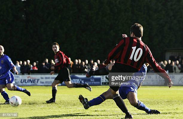 Ian Cambridge of Histon scores the opening goal during the FA Cup first round match between Histon FC and Shrewsbury Town at The Bridge on November...