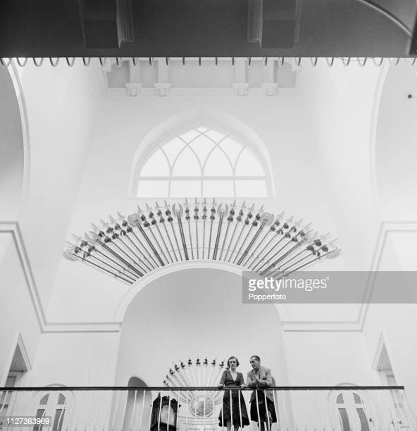 Ian Campbell 11th Duke of Argyll and Margaret Campbell Duchess of Argyll pictured together standing above the main hall in the galleried inner tower...