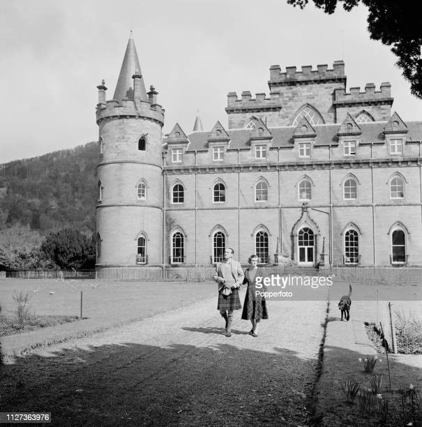 Ian Campbell 11th Duke of Argyll and Margaret Campbell Duchess of Argyll pictured together strolling in the grounds of Inveraray Castle the seat of...