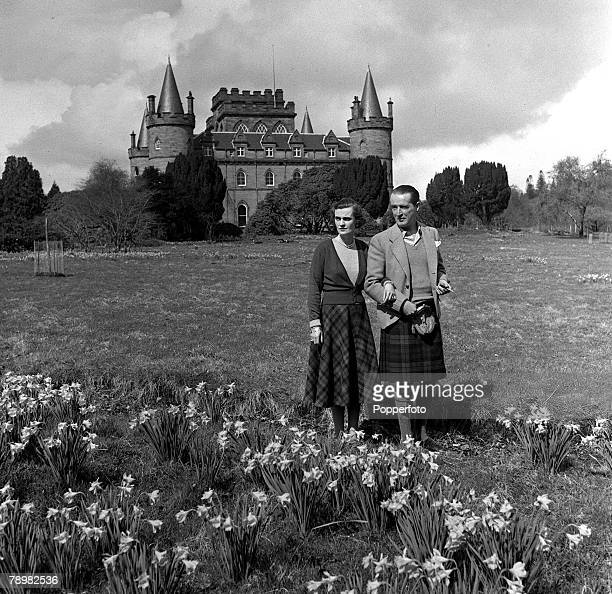 1953 Ian Campbell 11th Duke of Argyll and Margaret Campbell Duchess of Argyll stroll around the grounds of Inveraray Castle now to be opened to the...