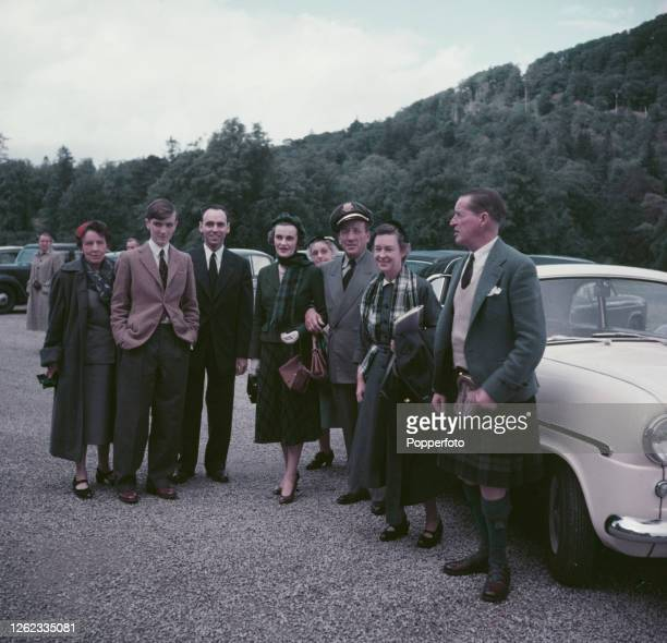 Ian Campbell, 11th Duke of Argyll posed on right with Margaret Campbell, Duchess of Argyll , 4th from left, as they greet guests invited to a...