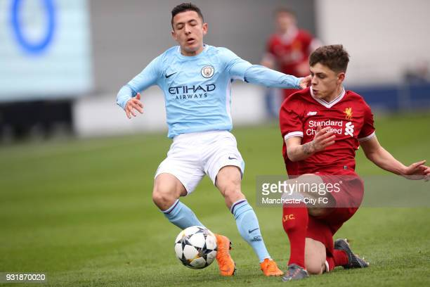 Ian Carlo Poveda of Manchester City and Adam Lewis of Liverpool during the UEFA Youth League QuarterFinal at Manchester City Football Academy on...