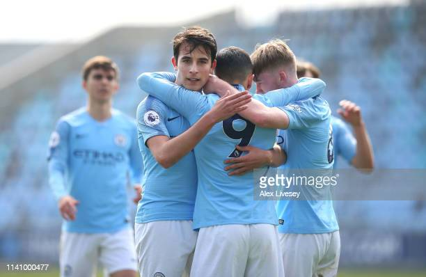 Ian Carlo PovedaOcampo of Manchester City celebrates with Eric Garcia after scoring their third goal during the Premier League 2 match between...