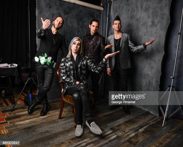 Ian Casselman Josh Ramsay Matt Webb and Mike Ayley of Marianas Trench pose at the 2017 Juno Awards Portrait Studio at the Canadian Tire Centre on...