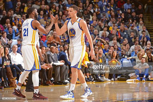 Ian Clark and Klay Thompson of the Golden State Warriors high five during the game against the Indiana Pacers on December 5 2016 at ORACLE Arena in...