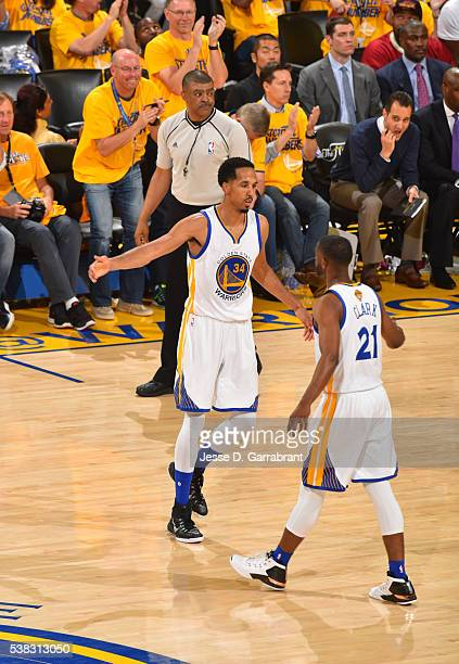 Ian Clark and Shaun Livingston of the Golden State Warriors give each other high fives against the Cleveland Cavaliers during the 2016 NBA Finals...