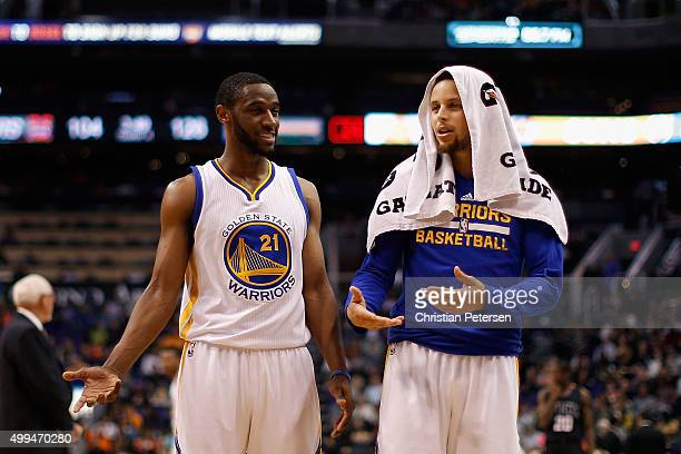 Ian Clark and Stephen Curry of the Golden State Warriors talk during the NBA game against the Phoenix Suns at Talking Stick Resort Arena on November...