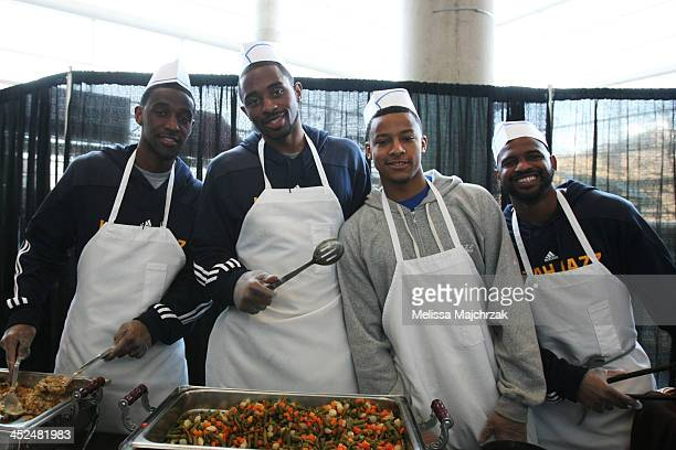 Ian Clark Mike Harris Trey Burke and John Lucas III of the Utah Jazz during the we carewe share Thanksgiving Dinner feeding the homeless at...