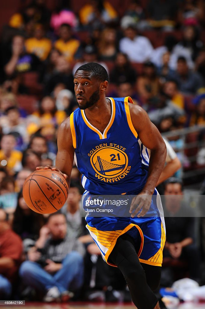 Ian Clark #21 of the Golden State Warriors brings the ball up court against the Los Angeles Lakers during a preseason game on October 22, 2015 at Honda Center in Anaheim, California.