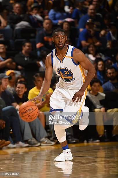 Ian Clark of the Golden State Warriors dribbles the ball against the Los Angeles Clippers during a preseason game on October 4 2016 at Oracle Arena...