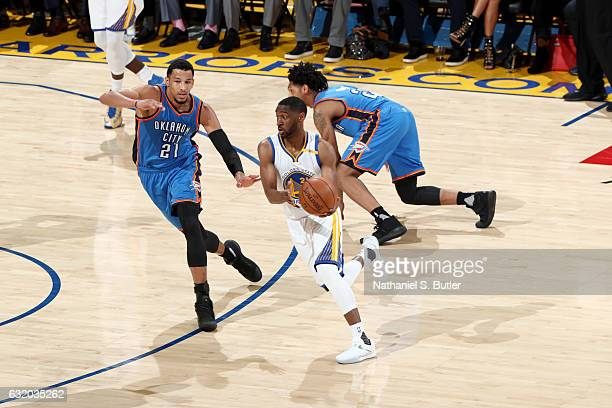 Ian Clark of the Golden State Warriors handles the ball against the Oklahoma City Thunder on January 18 2017 at ORACLE Arena in Oakland California...