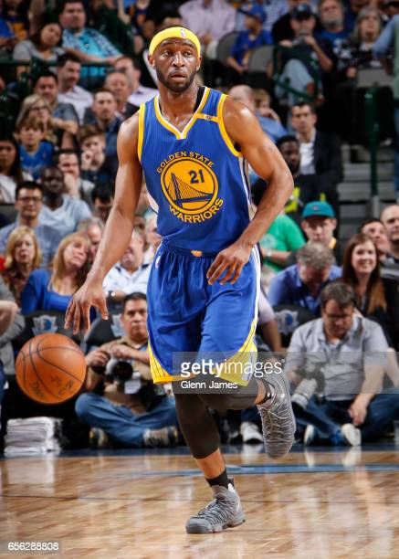 Ian Clark of the Golden State Warriors handles the ball against the Dallas Mavericks during the game on March 21 2017 at the American Airlines Center...