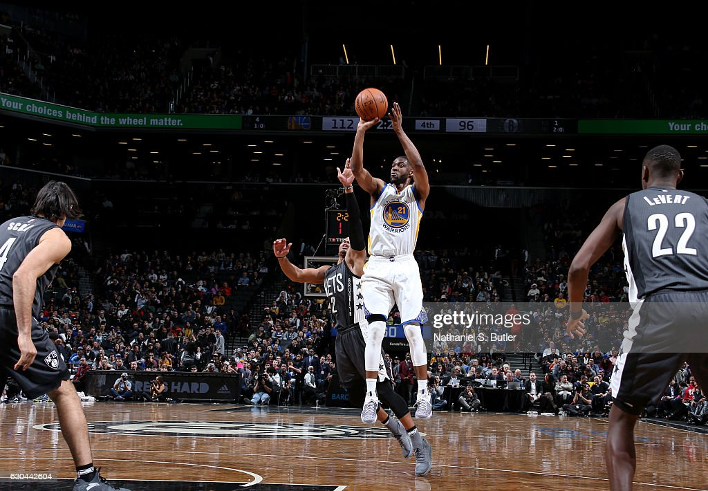 Ian Clark #21 of the Golden State Warriors shoots the ball against the Brooklyn Nets on December 22, 2016 at Barclays Center in Brooklyn, NY.