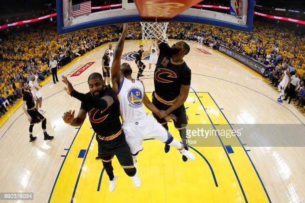 Ian Clark of the Golden State Warriors throws up a shot against Kyrie Irving and Tristan Thompson of the Cleveland Cavaliers in Game 2 of the 2017...