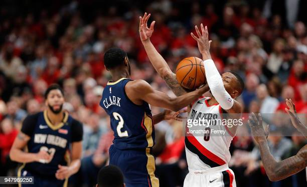 Ian Clark of the New Orleans Pelicans drives against Damian Lillard of the Portland Trail Blazers during Game One of the Western Conference...
