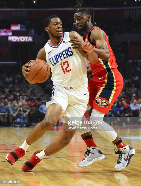 Ian Clark of the New Orleans Pelicans guards Tyrone Wallace of the Los Angeles Clippers as he drives to the basket in the game at Staples Center on...