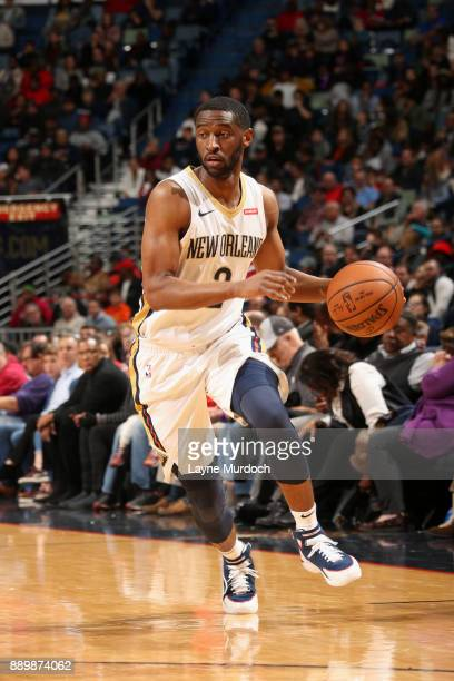 Ian Clark of the New Orleans Pelicans handles the ball against the Philadelphia 76ers on December 10 2017 at the Smoothie King Center in New Orleans...