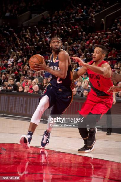 Ian Clark of the New Orleans Pelicans handles the ball during the game against the Portland Trail Blazers on December 2 2017 at the Moda Center Arena...