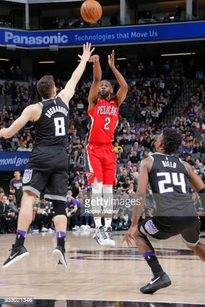 Ian Clark of the New Orleans Pelicans shoots against Bogdan Bogdanovic of the Sacramento Kings on March 7 2018 at Golden 1 Center in Sacramento...