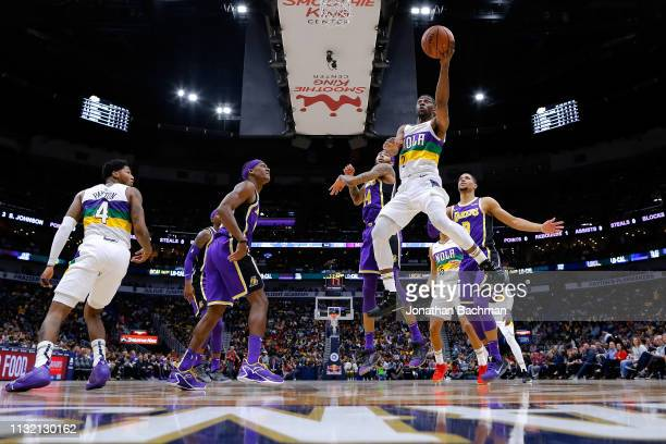 Ian Clark of the New Orleans Pelicans shoots against Brandon Ingram of the Los Angeles Lakers during the first half at the Smoothie King Center on...