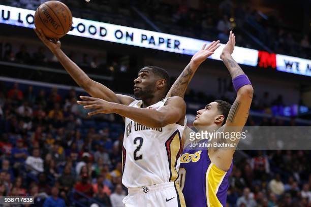 Ian Clark of the New Orleans Pelicans shoots against Kyle Kuzma of the Los Angeles Lakers during the first half at the Smoothie King Center on March...