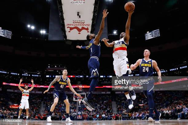 Ian Clark of the New Orleans Pelicans shoots against Will Barton of the Denver Nuggets during a game at the Smoothie King Center on January 30 2019...