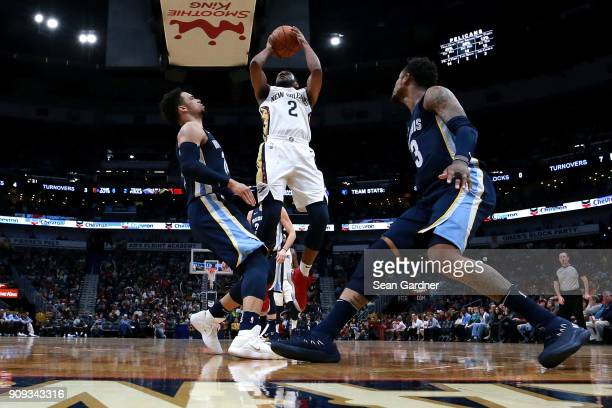 Ian Clark of the New Orleans Pelicans shoots over Dillon Brooks of the Memphis Grizzlies during the first half of a NBA game at the Smoothie King...