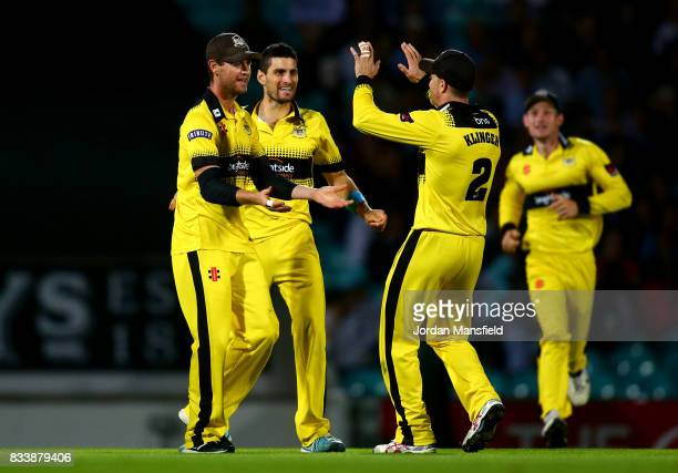 Ian Cockbain of Gloucestershire celebrates with his teammates after running out Moises Henriques of Surrey during the NatWest T20 Blast match between...