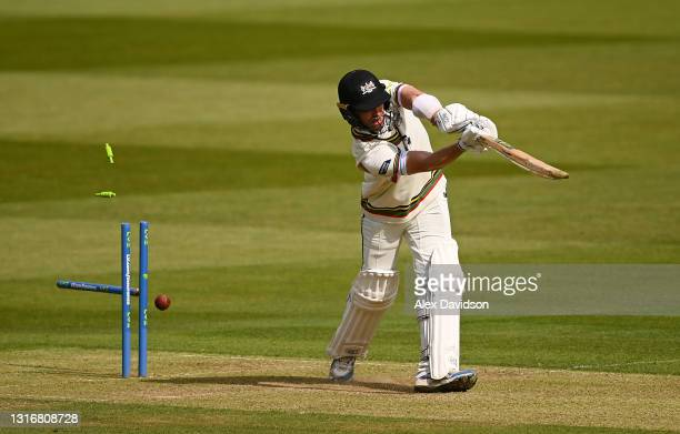 Ian Cockbain of Gloucestershire is bowled by James Harris of Middlesex during Day Two of the LV= Insurance County Championship match between...