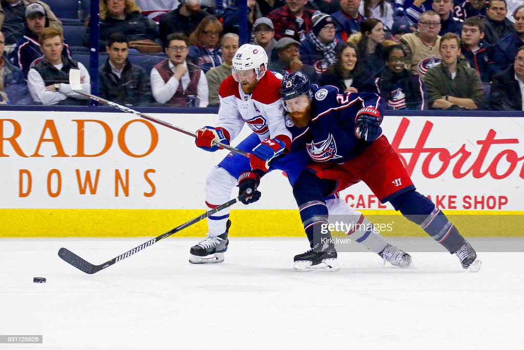 Ian Cole #23 of the Columbus Blue Jackets and Jeff Petry #26 of the Montreal Canadiens battle for control of the puck during the third period on March 12, 2018 at Nationwide Arena in Columbus, Ohio. Columbus defeated Montreal 5-2.