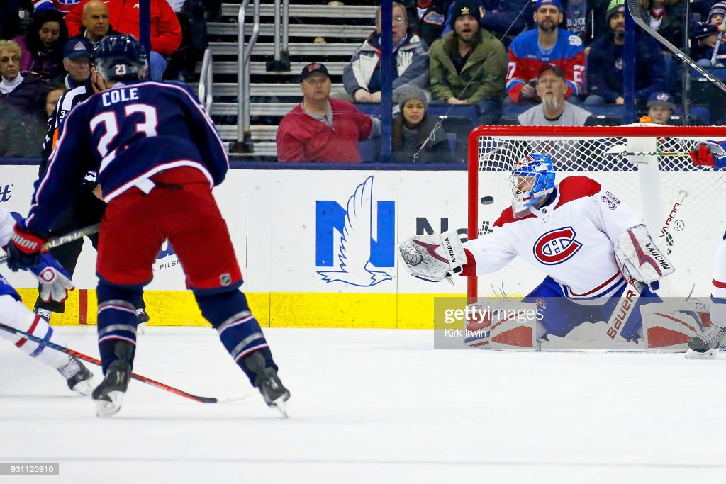 Ian Cole #23 of the Columbus Blue Jackets beats Charlie Lindgren #39 of the Montreal Canadiens for a goal during the third period on March 12, 2018 at Nationwide Arena in Columbus, Ohio. Columbus defeated Montreal 5-2.