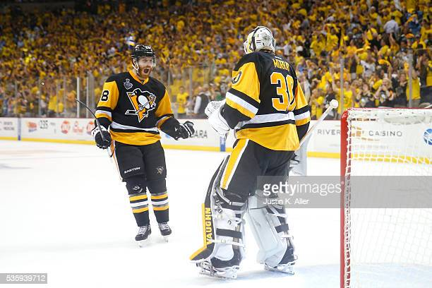 Ian Cole of the Pittsburgh Penguins celebrates with Matt Murray after defeating the San Jose Sharks 32 in Game One of the 2016 NHL Stanley Cup Final...