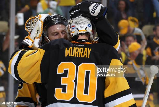 Ian Cole of the Pittsburgh Penguins congratulates goaltender Matt Murray after they defeated the Nashville Predators 41 in Game Two of the 2017 NHL...