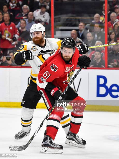 Ian Cole of the Pittsburgh Penguins defends against Mark Stone of the Ottawa Senators in Game Six of the Eastern Conference Final during the 2017 NHL...
