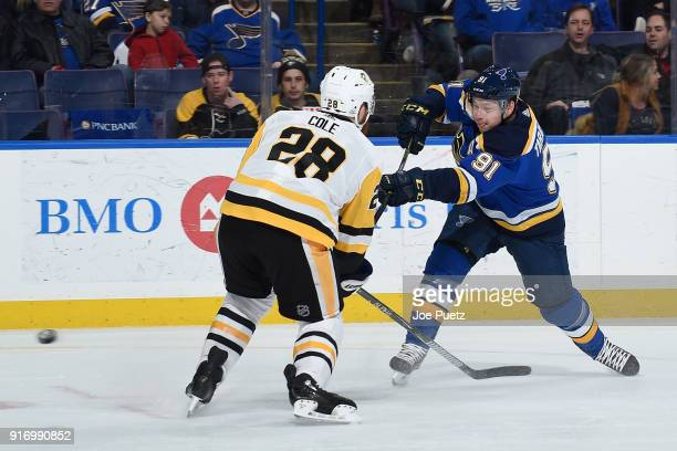 Ian Cole of the Pittsburgh Penguins defends against Vladimir Tarasenko of the St Louis Blues as he takes a shot at Scottrade Center on February 11...
