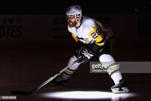 Ian Cole of the Pittsburgh Penguins skates on the ice before the start of the NHL game against the Arizona Coyotes at Gila River Arena on December 16...