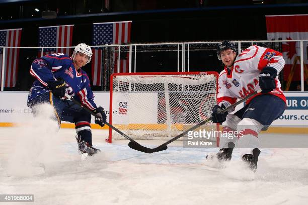 Ian Cole of the USA and Andrew Gordon of Canada pose during an International Ice Hockey Tour 2014 Media Opportunity at Perth Arena on July 10 2014 in...