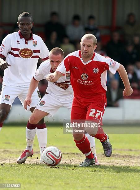Ian Craney of Accrington Stanley moves away with the ball watched by Josh Walker and Abdul Osman of Northampton Town during the npower League Two...