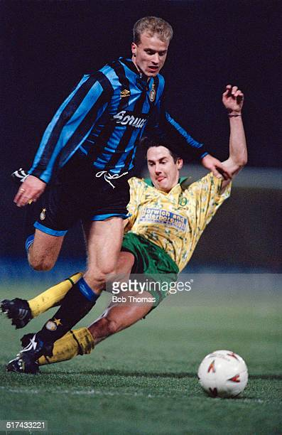 Ian Culverhouse of Norwich City fouls Dennis Bergkamp of Inter Milan during a UEFA Cup Third round First leg match at Carrow Road Norwich 24th...